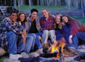Teens Sitting Around a Campfire